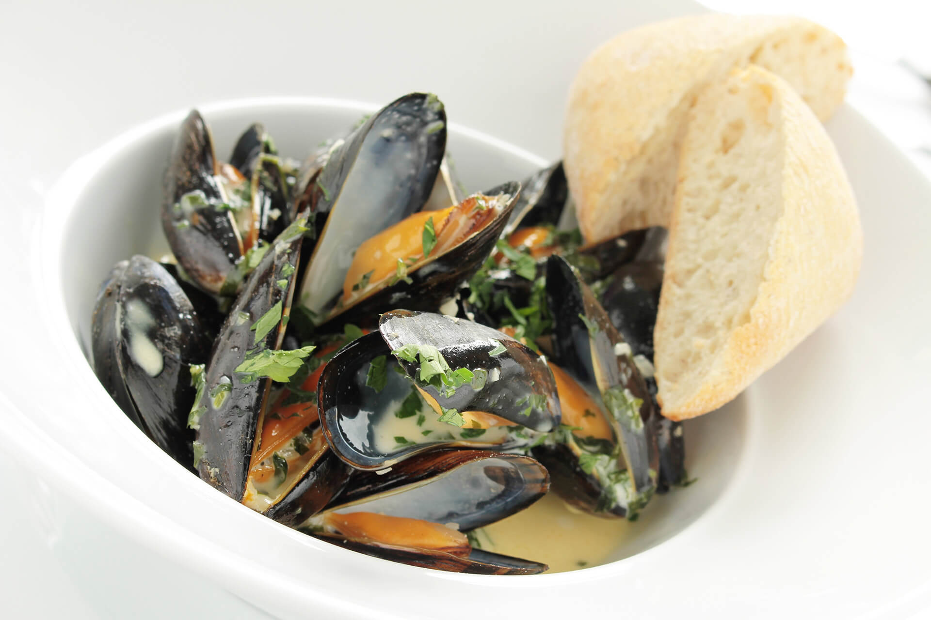 Green Lipped mussels broiled in white wine with garlic and herbs.