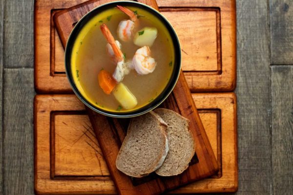 Sea bass fillet and prawns with root vegetables in an oregano infused broth.