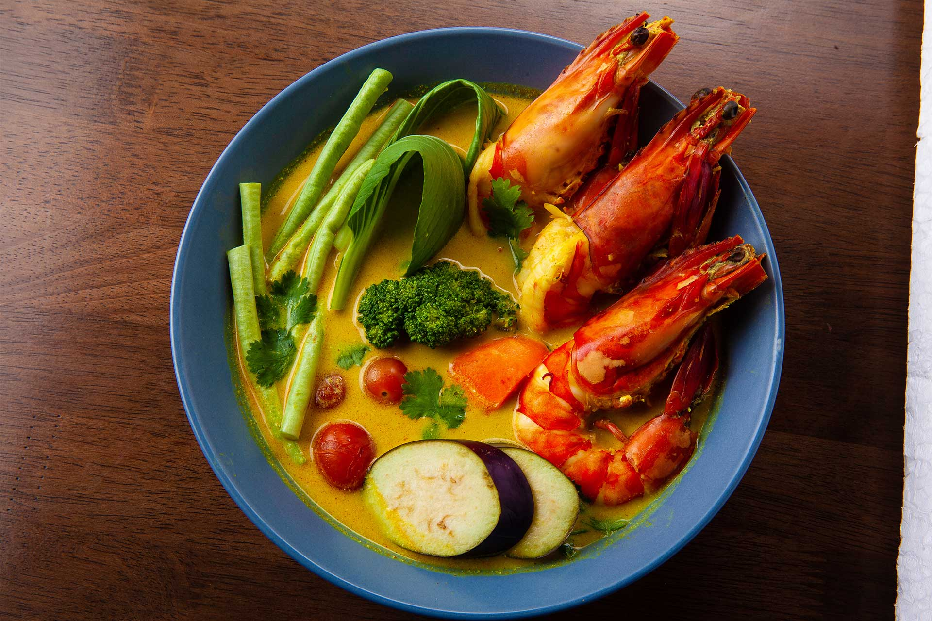 Grilled Prawns in a rich turmeric and coconut broth.