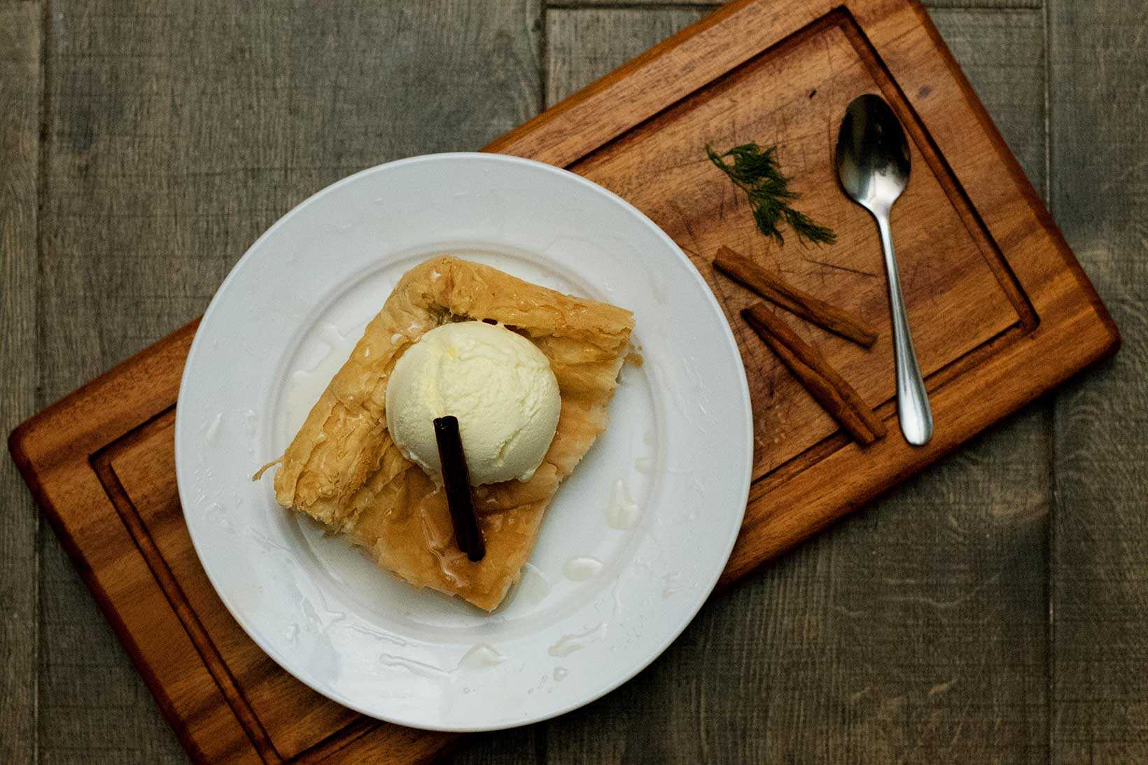 Creamy custard wrapped in phyllo pastry. Served with Honey syrup and Vanilla Ice cream.