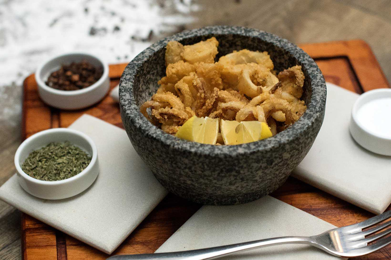 Fresh squid, battered and lightly fried served with lemon wedge.