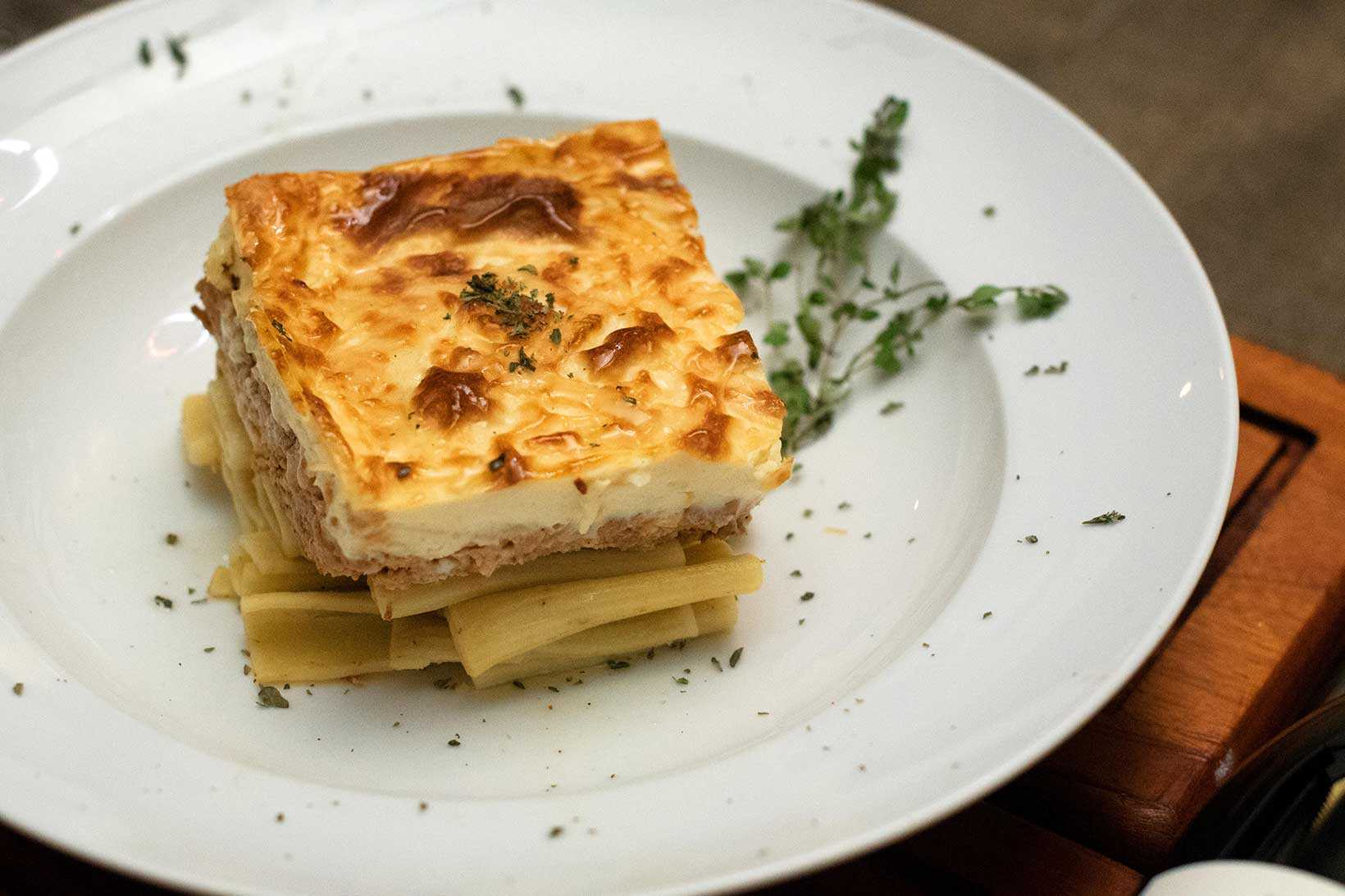 The Greek version of Lasagna. Layers of spiced minced meat with pasta and topped with a cheese infused bechamel.