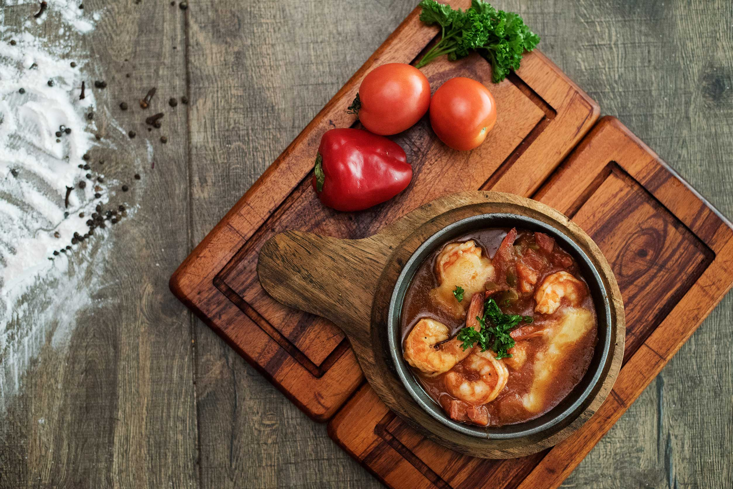 Grilled Prawns infused with ouzo in a rich tomato and herb sauce with feta cheese.