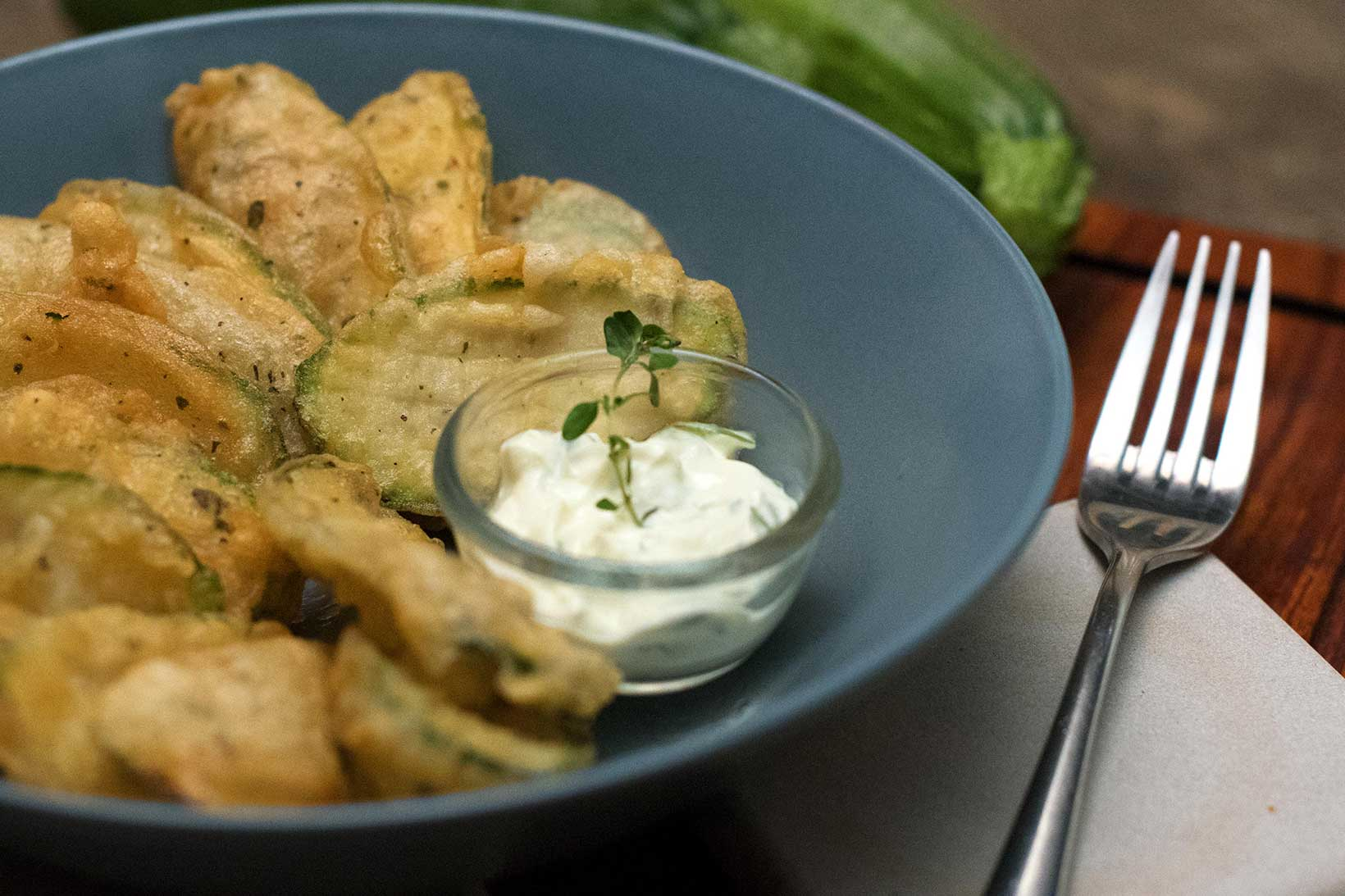 Thinly sliced and lightly battered zucchini slices with tzatziki dipping sauce.