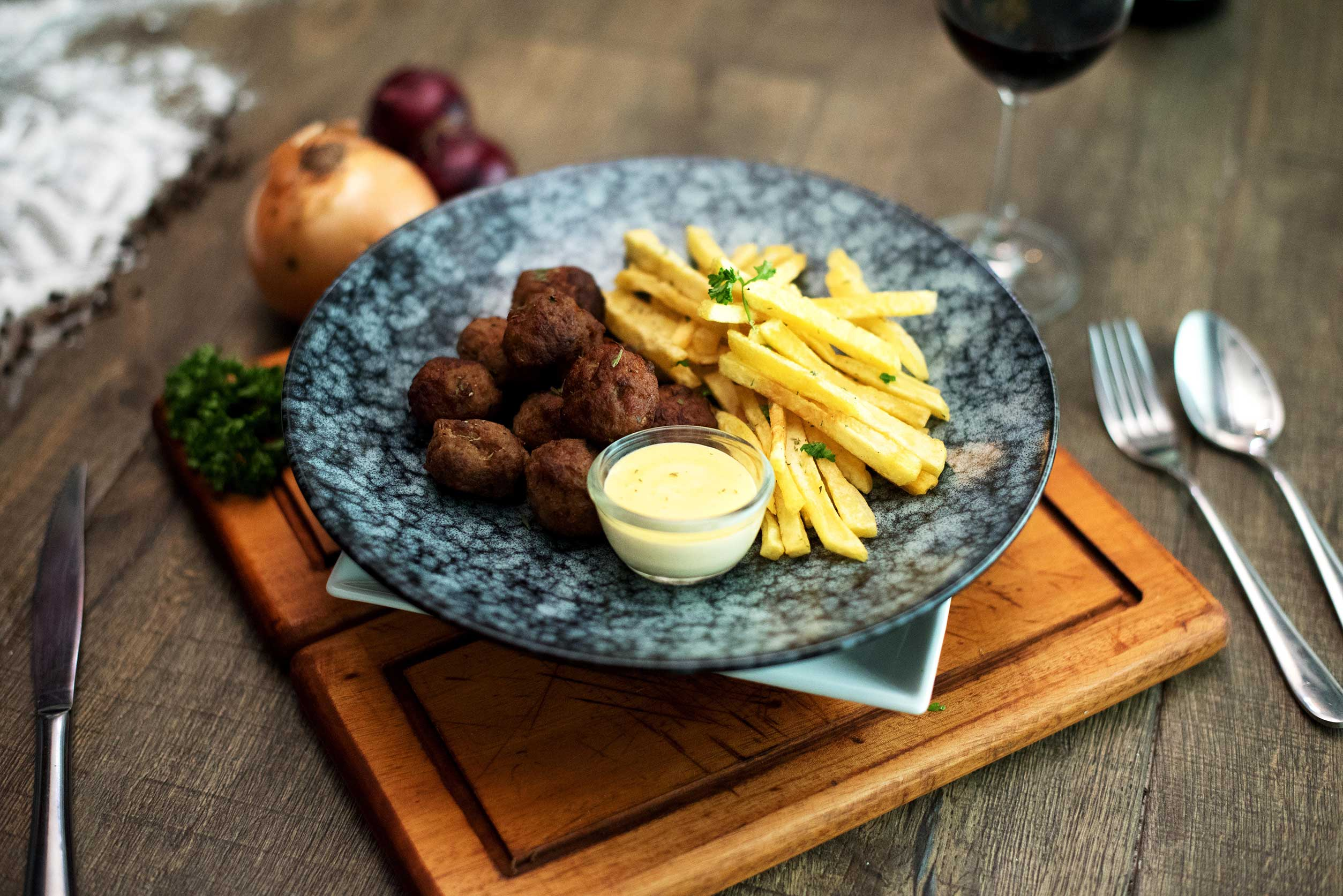 Greek spiced meatballs with fresh fried potatoes.