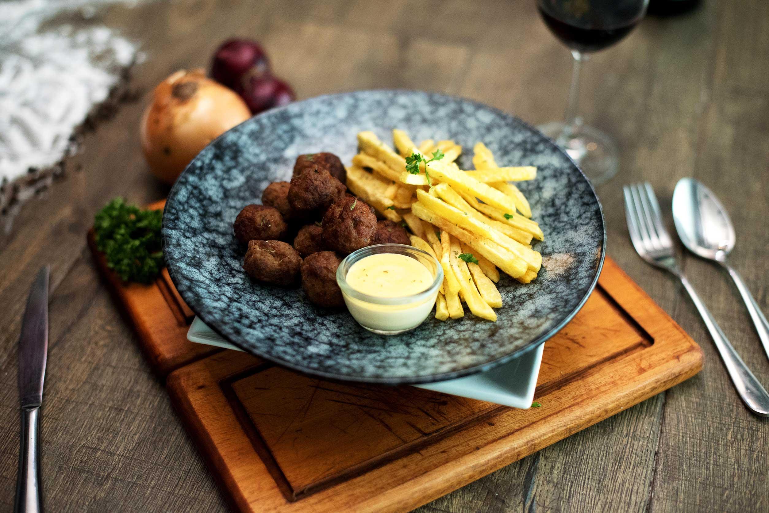 Greek spiced meatballs with fresh fried potatoes.