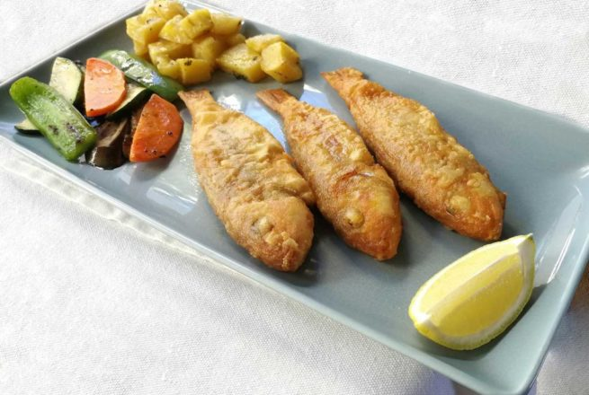 Pan Fried Red Mullet served with roasted potatoes or rice and lemon wedges.