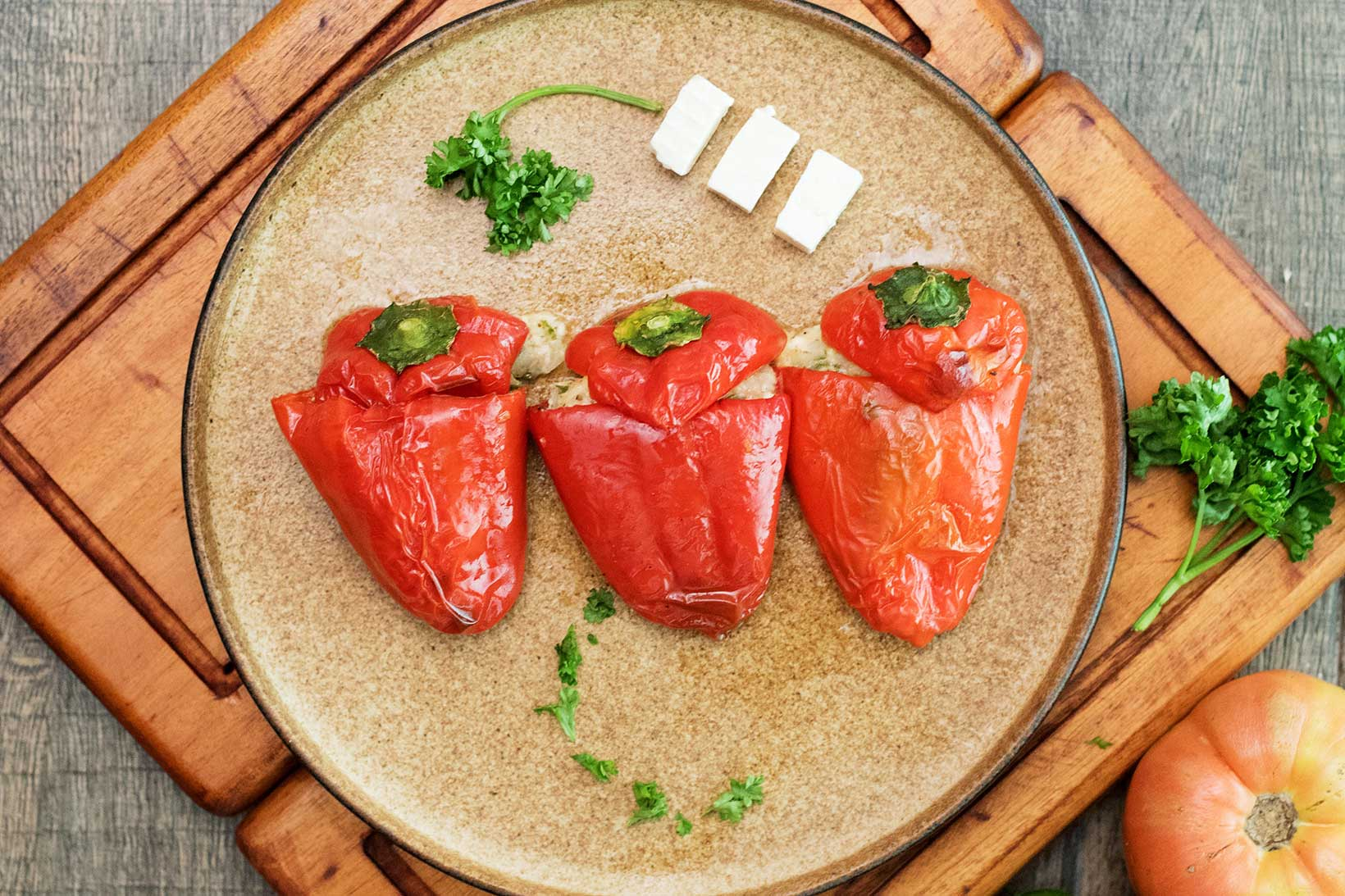 Slow cooked peppers stuffed with herb infused feta cheese.