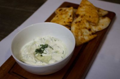 Fresh Greek yogurt combined with garlic and cucumber, dressed with olive oil.
