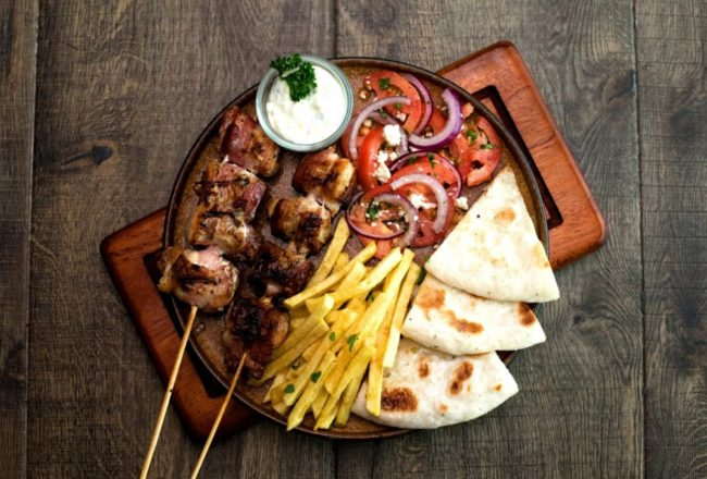 Grilled seasoned skewers served with tomato, feta cheese & onion salad, freshly made pitta bread and hand cut fries.