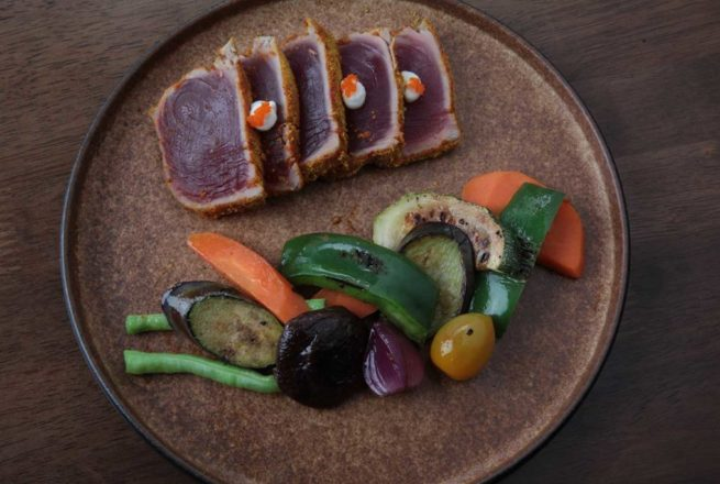 Seared tuna fillet with lemon soy dressing served with freshly grilled vegetables