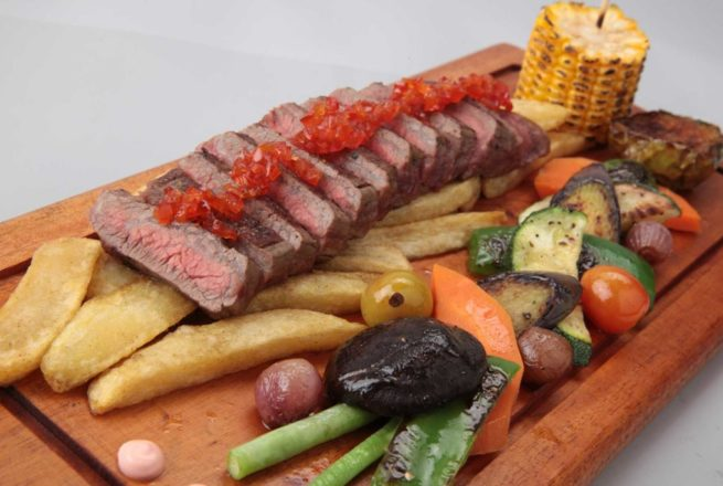 Rich wagyu skirt steak topped with spicy chili jam served with roasted vegetables. Served with fries and paprika aioli.